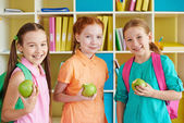 Three charming girls with green apples — Foto de Stock