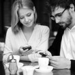 Young couple using their cellphones — Stock Photo #53815807