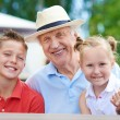 Senior man with two grandchildren — Stock Photo #53810277