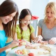Girls preparing food with mother — Stock Photo #53810347