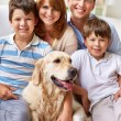 Happy family with dog — Stock Photo #53810451