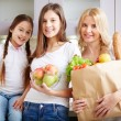 Three females with foodstuff — Stock Photo #53810555