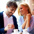 Affectionate couple having coffee in cafe — Stock Photo #53815741