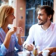 Affectionate couple having coffee in cafe — Stock Photo #53815749