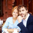 Affectionate couple having coffee in cafe — Stock Photo #53815783