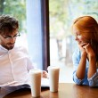 Young couple having rest in cafe — Stock Photo #53815805
