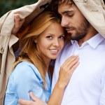 Young female under her boyfriend jacket — Stock Photo #53815865
