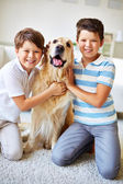 Two boys with dog — Stock Photo