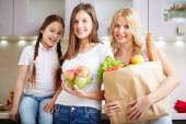 Three females with foodstuff — Stock Photo