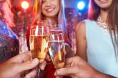 Friends cheering up with champagne — Stock Photo