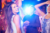 Joyful girls and guys dancing — Stock Photo