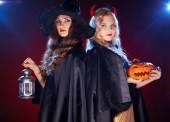 Two witches with lantern — Stock Photo