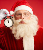 Santa with alarm clock — Foto de Stock