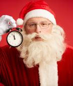 Santa with alarm clock — Stockfoto