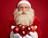 Santa with toy balls — Stockfoto