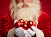 Santa holding decorative toy balls — Stockfoto
