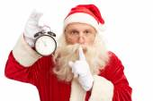 Santa Claus with alarm clock — Stock Photo