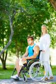 Nurse walking with male patient — Stock Photo