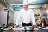 Chef at the kitchen — Stock Photo