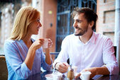 Affectionate couple having coffee in cafe — Stock Photo