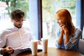 Young couple having rest in cafe — Foto Stock
