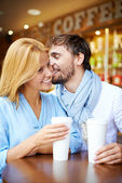 Young couple sitting in cafe — Stock Photo
