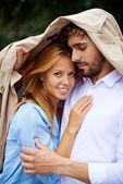 Young female under her boyfriend jacket — Foto de Stock