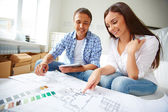 Young couple sitting in new flat — Foto de Stock