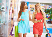 Happy girls with paperbags — Stock Photo