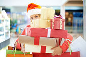Young woman with Christmas presents — Stock Photo