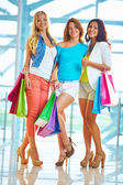Three shoppers — Stock Photo