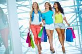 Three pretty shoppers in trade center — Stock Photo