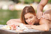 Woman enjoying massage outdoors — Foto de Stock