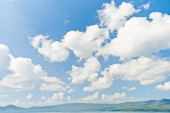Cloudy sky over mountains — Stock Photo