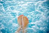 Female legs in hot tub — Stock Photo