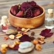 Rose petals and scented oils — Stock Photo #55401859