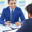 Businessman in suit looking at colleague — Stock Photo #55409593