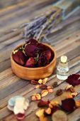 Petals and bottle of aromatic liquid — Stock Photo
