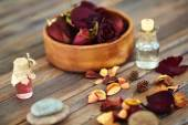 Petals and aromatic oils — Stock Photo
