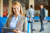 Businesswoman with touchpad at the airport — Stock Photo