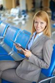Successful woman at the airport — Stock Photo