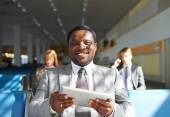Manager  with touchpad in airport — Stockfoto