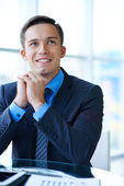 Businessman sitting at workplace — Stock Photo
