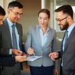 Businesswoman pointing at document — Stock Photo #55466077