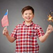 Boy with benghal light and American flag — Stock Photo #55466391