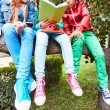 Schoolkids sitting on tree and reading — Stock Photo #55467097