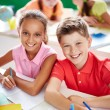 Two schoolkids drawing — Stock Photo #55467425