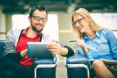 Business partners with touchpad — Stock Photo