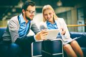 Business people using touchpad — Stock Photo