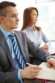 Businesspeople at conference — Stock Photo